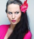 Mujer que hace una cara divertida Fotos de archivo libres de regalías
