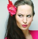 Mujer que hace una cara divertida Fotografía de archivo libre de regalías