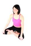 Mujer que hace yoga Imagenes de archivo