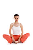 Mujer que hace yoga Fotos de archivo libres de regalías