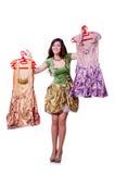 Mujer que intenta elegir el vestido Imagen de archivo libre de regalías