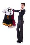 Mujer que intenta la nueva ropa Fotografía de archivo libre de regalías