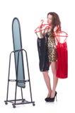 Mujer que intenta la nueva ropa Foto de archivo libre de regalías