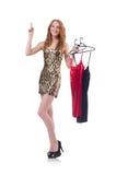 Mujer que intenta la nueva ropa Imagen de archivo