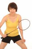 Mujer que juega a bádminton Fotografía de archivo libre de regalías