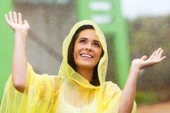 Mujer que juega en lluvia Foto de archivo libre de regalías