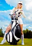 mujer que juega a golf Fotografía de archivo libre de regalías