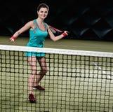 Mujer que juega a tenis Foto de archivo