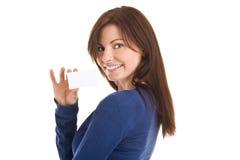 Mujer que lleva a cabo asunto en blanco Foto de archivo libre de regalías