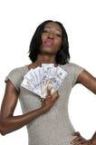Mujer que lleva a cabo 100 cuentas de dólar Imagen de archivo