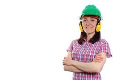 Mujer que lleva el casco y los auriculares protectores Fotos de archivo libres de regalías