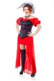 Mujer que lleva el vestido rojo con velo imagenes de archivo