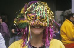 Mujer que lleva a Mardi Gras Mask, New Orleans, Luisiana Fotografía de archivo libre de regalías