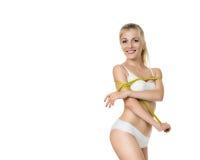 Mujer que mide forma perfecta de sano entonada hermoso de la cintura aislado en el fondo blanco Imagen de archivo libre de regalías