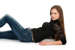 Mujer que miente en el suelo Imagen de archivo libre de regalías
