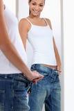 Mujer que mira en un espejo Imagen de archivo libre de regalías