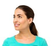 Mujer que mira lejos contra el fondo blanco foto de archivo libre de regalías