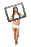 Mujer que mira a través de marco Fotografía de archivo libre de regalías