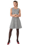 Mujer que modela a Mini Dress With Arms Folded corto Foto de archivo