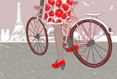 Mujer que monta una bicicleta en París ilustración del vector