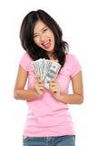 Mujer que muestra el dinero aislado en el fondo blanco Foto de archivo