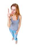 Mujer que muestra el finger encima de la situación integral de la muestra aislado Foto de archivo