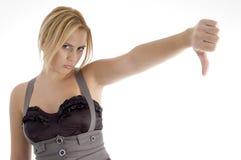 Mujer que muestra el pulgar abajo Fotos de archivo