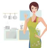 Mujer que muestra la muestra aceptable. Muchacha que cocina en su cocina Imagen de archivo