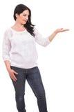 Mujer que muestra la palma vacía Imagen de archivo libre de regalías