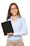 Mujer que muestra la PC de la tablilla Foto de archivo libre de regalías