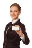 Mujer que muestra la tarjeta de visita foto de archivo