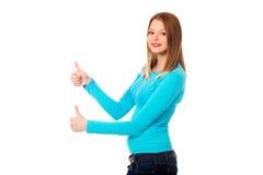 Mujer que muestra los pulgares para arriba con ambas manos Imagenes de archivo