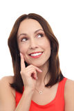 Mujer que piensa con el dedo en la barbilla Imagen de archivo