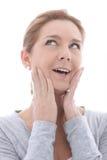 Mujer que piensa con sus manos a su cara Imagen de archivo