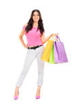 Mujer que presenta con los bolsos de compras Foto de archivo