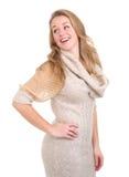 Mujer que ríe y que mira sobre hombro Fotografía de archivo