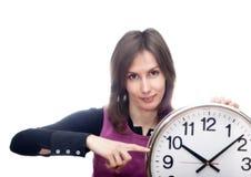 Mujer que señala blanco aislado reloj Imágenes de archivo libres de regalías