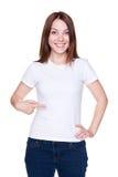 Mujer que señala en su camiseta blanca Imagenes de archivo