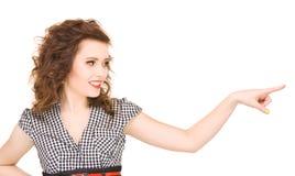 Mujer que señala su dedo Foto de archivo