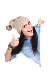 Mujer que señala su dedo en la cartelera blanca Imagen de archivo
