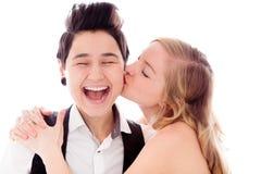 Mujer que se besa a su socio lesbiano Fotografía de archivo libre de regalías
