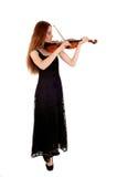 Mujer que se coloca con el violín Imagen de archivo libre de regalías