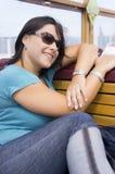 Mujer que se sienta Fotos de archivo libres de regalías