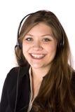 Mujer que sonríe con el receptor de cabeza Foto de archivo libre de regalías