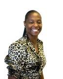 Mujer que sonríe en la impresión del leopardo Imagenes de archivo