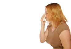 Mujer que sopla su nariz Fotos de archivo libres de regalías