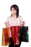 Mujer que sostiene bolsos de compras Fotografía de archivo libre de regalías