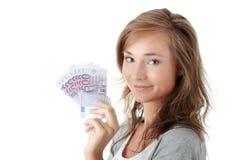 Mujer que sostiene el dinero euro Imagen de archivo