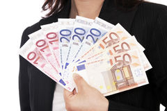 Mujer que sostiene el dinero euro Imágenes de archivo libres de regalías