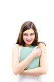 Mujer que sostiene el libro y que parece feliz en el fondo blanco del copyspace Fotos de archivo